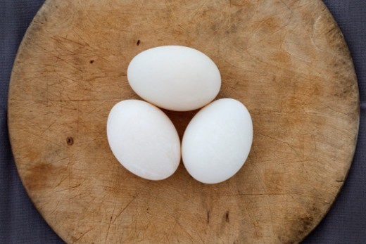 Duck eggs on a wooden board : Stock Photo