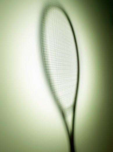 Stock Photo: 1672R-77952 Shadow of a tennis racket