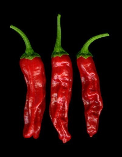 Stock Photo: 1672R-78060 Three red peperoncini peppers