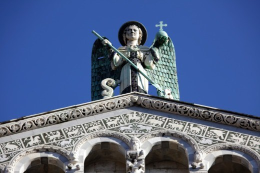 Stock Photo: 1672R-80004 The angel Saint Michael on the top of Church of San Michele in Foro.