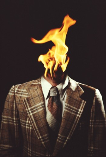 Flame coming from businessman's neck (digital composite) : Stock Photo