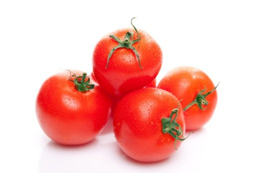 Tomatoes isolated on white : Stock Photo