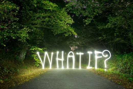 'What if ?' written in light across a road : Stock Photo