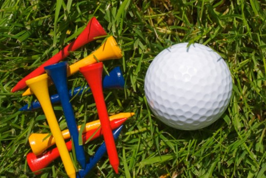 Stock Photo: 1672R-8541 Golf ball and wooden tees on grass