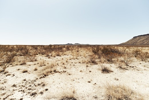 Stock Photo: 1672R-88950 Texas landscape near Big Bend National Park.  Desert ad scrub dominate the low lands underneath the hills.