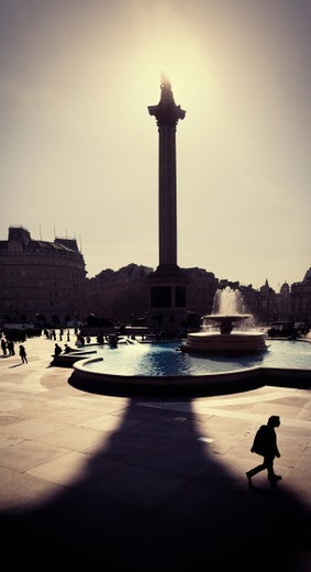 A silohuetted Nelson's Column in Trafalgar Square, London in the midday sun. : Stock Photo