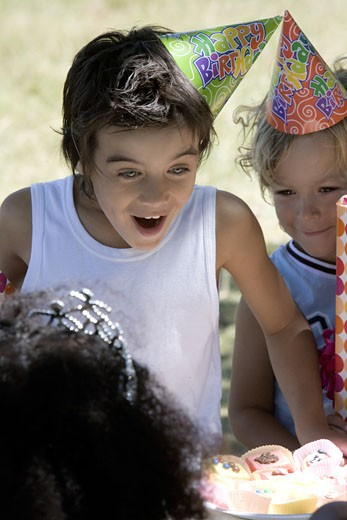 Stock Photo: 1680-147 Close-up of three children at a birthday party