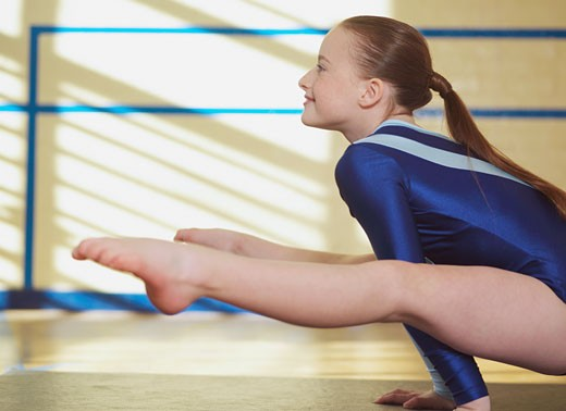 Stock Photo: 1691-119G Female gymnast balancing on her hands