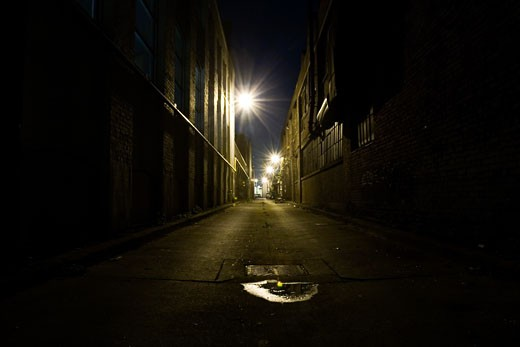 Buildings along a dark street : Stock Photo