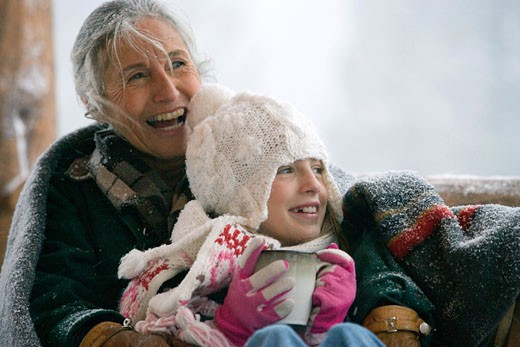 Senior woman with her granddaughter smiling : Stock Photo