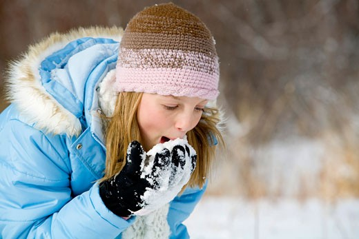 Stock Photo: 1698-172B Girl eating snow