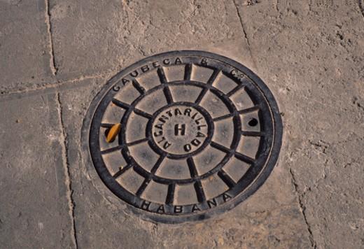 Havana, Cuba. A manhole cover in Havana, Cuba. : Stock Photo