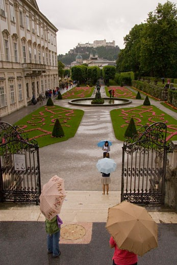 Stock Photo: 1701R-1185 Salzburg, Austria. Tourists wander through the Bishop's gardens in Salzburg in the rain.