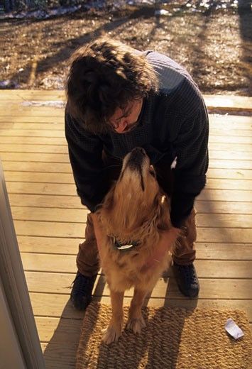 Annapolis, Maryland, United States. Kisses for man's best friend. : Stock Photo