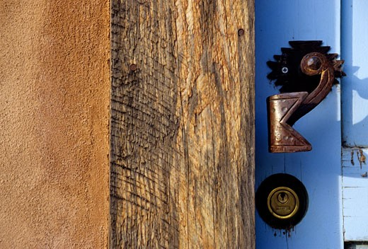 Santa Fe, New Mexico, United States. An old fashion iron door knob on an adobe house. : Stock Photo