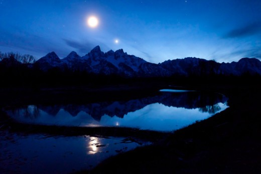 Stock Photo: 1701R-49875 The moon over the Teton Range.
