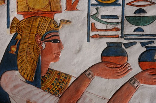 Queen Nefertari making an offering to Isis. : Stock Photo
