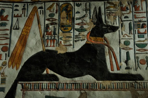 The god Anubis is stretched out on a tomb waiting to greet Nefertari. : Stock Photo