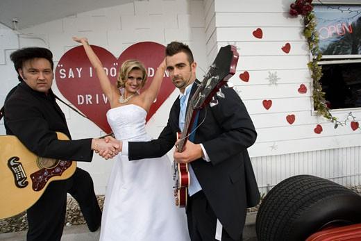 Stock Photo: 1703-112F Two men shaking hands with a bride at a drive-thru wedding chapel