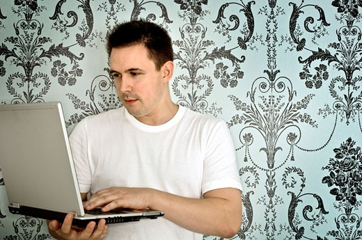 Stock Photo: 1710-117 Mid adult man using a laptop