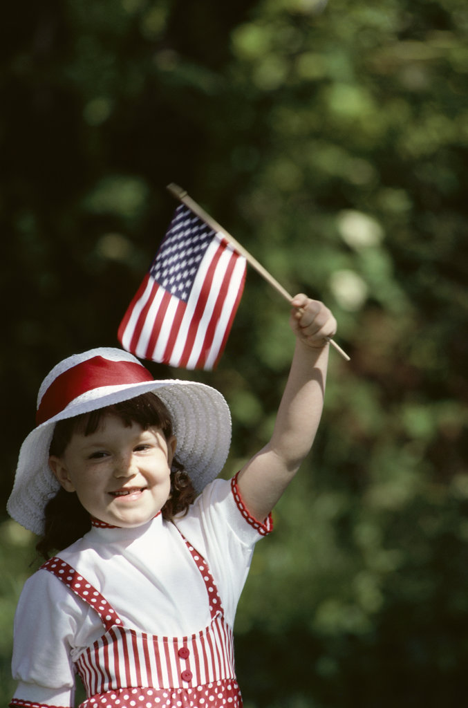 young girl with american flag : Stock Photo