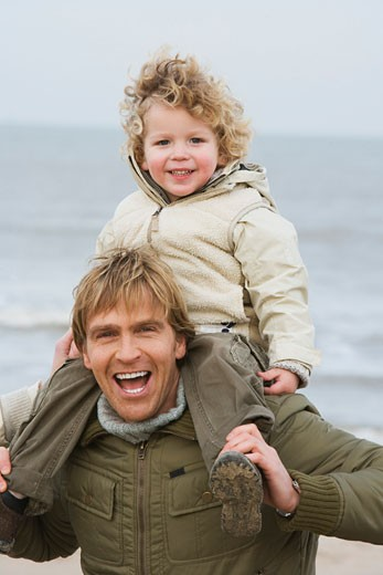 Stock Photo: 1727-107A Mid adult man carrying his son on his shoulders