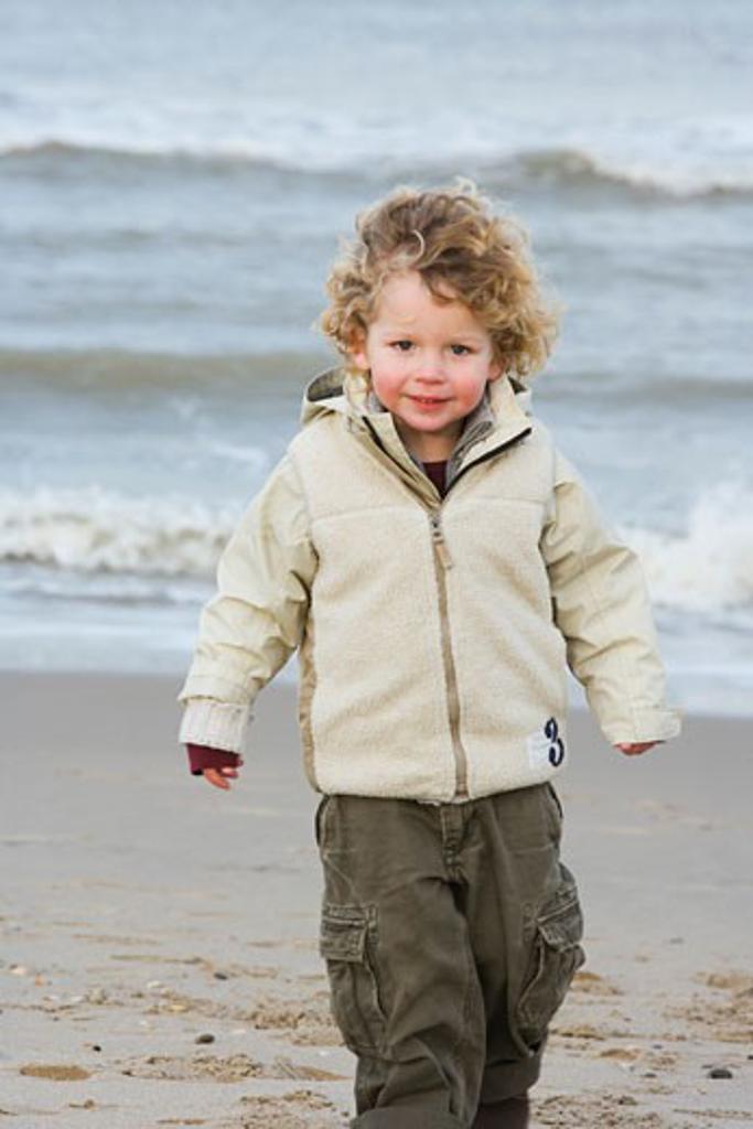 Boy walking on the beach : Stock Photo