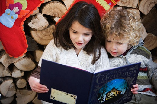 Stock Photo: 1727-120F Girl and boy reading a book