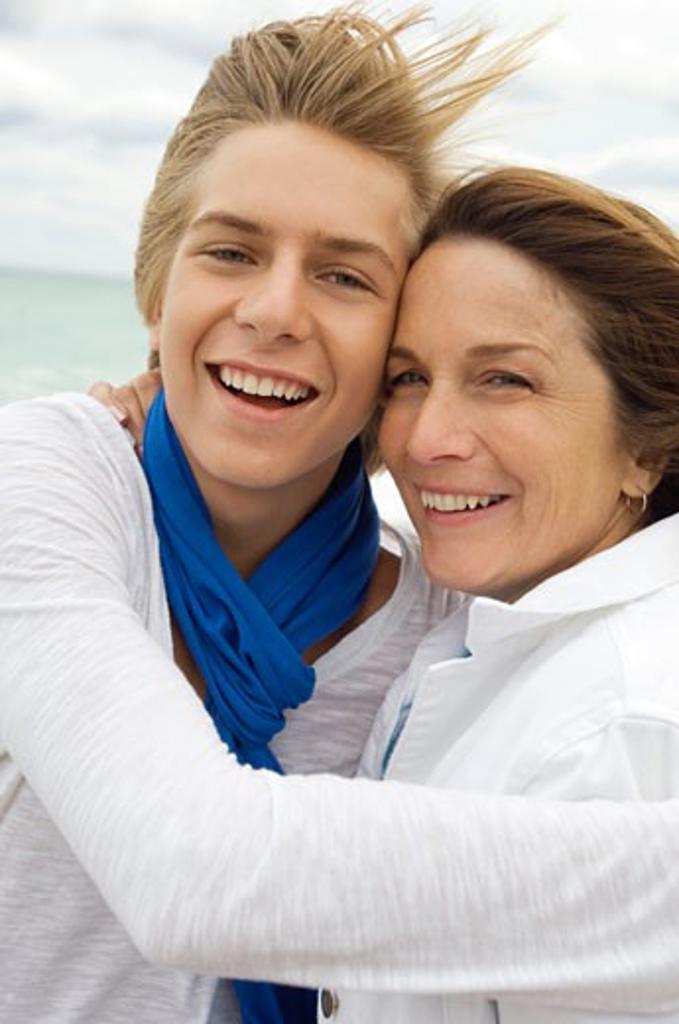 Stock Photo: 1738R-12046 Teenage boy hugging his grandmother