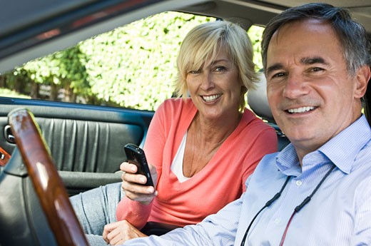 Couple in a car and smiling : Stock Photo