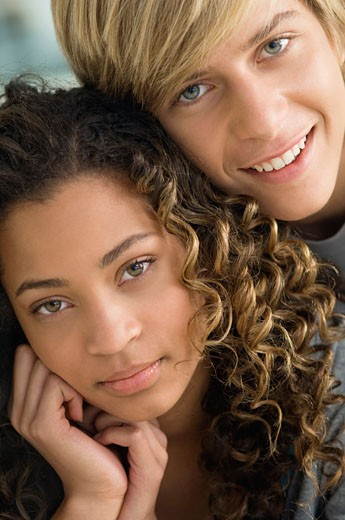 Teenage boy smiling with a girl : Stock Photo