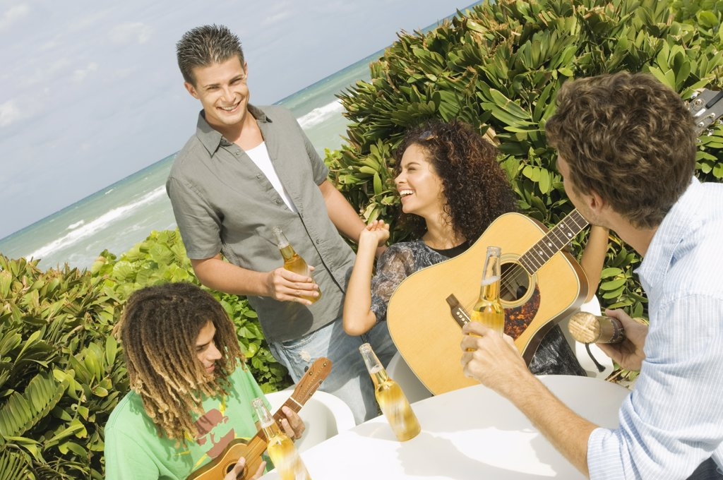 Stock Photo: 1738R-13020 Friends enjoying beer and music on vacations