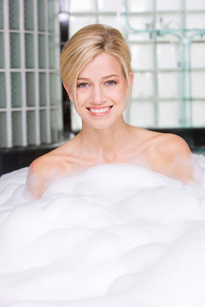 Woman taking a bubble bath : Stock Photo