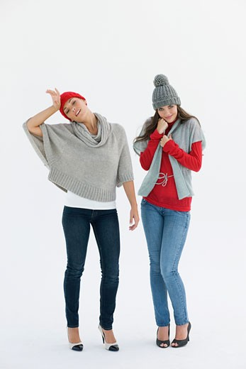 Two women standing in warm clothing : Stock Photo