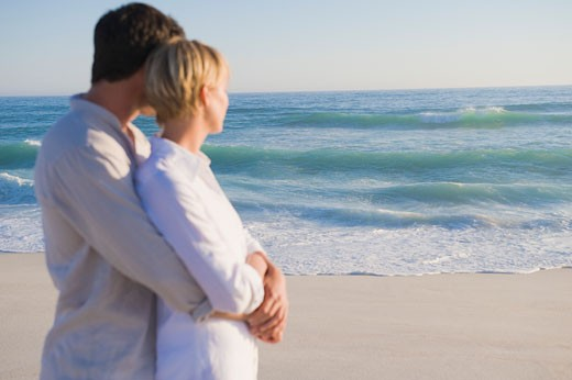 Man embracing a woman from behind : Stock Photo