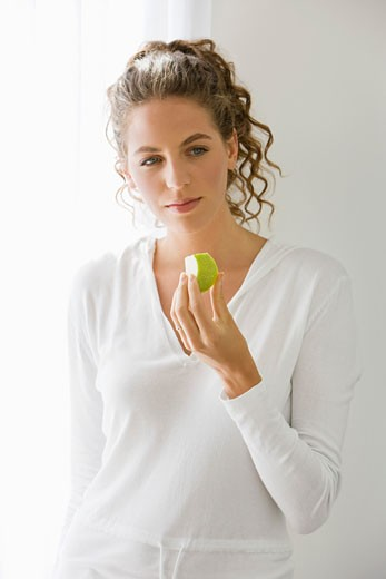 Close-up of a woman eating fruit : Stock Photo
