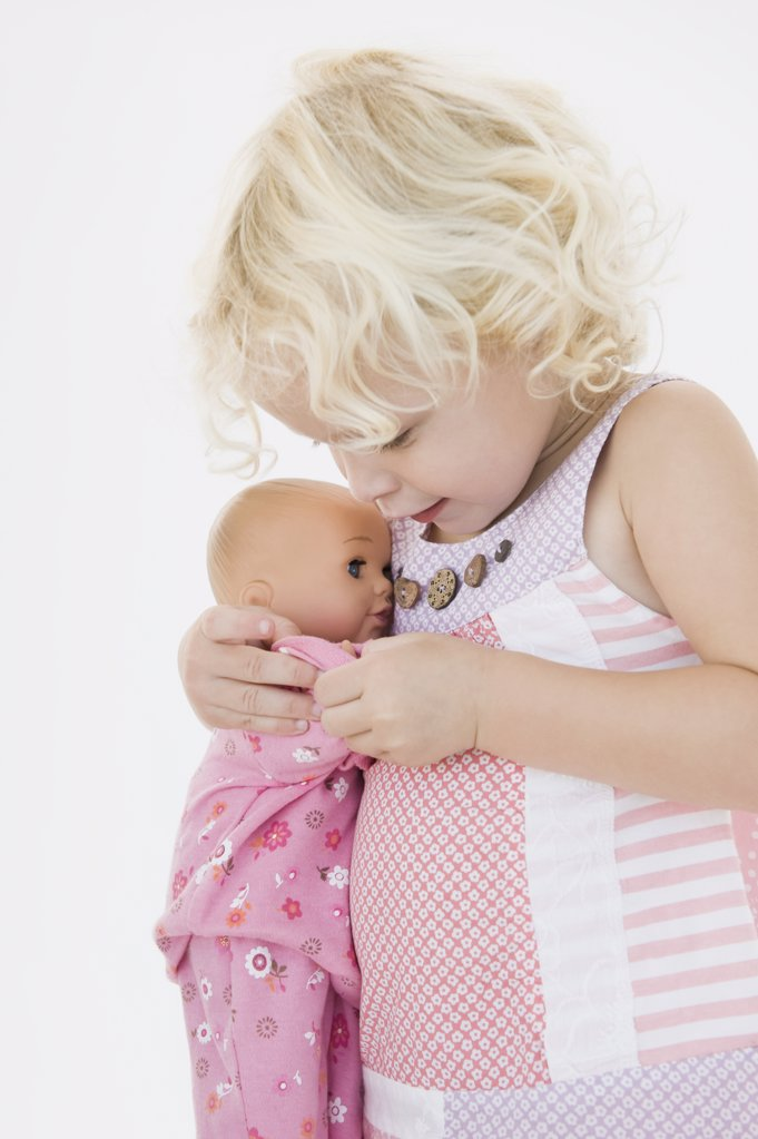 Girl hugging a doll : Stock Photo