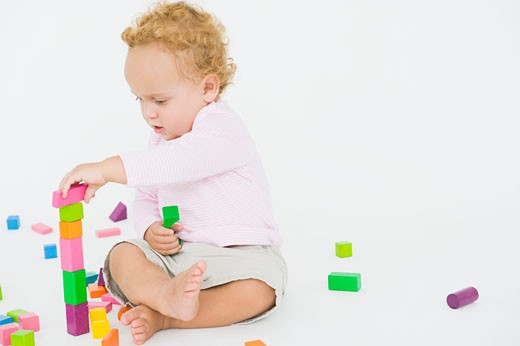 Baby boy playing with blocks : Stock Photo