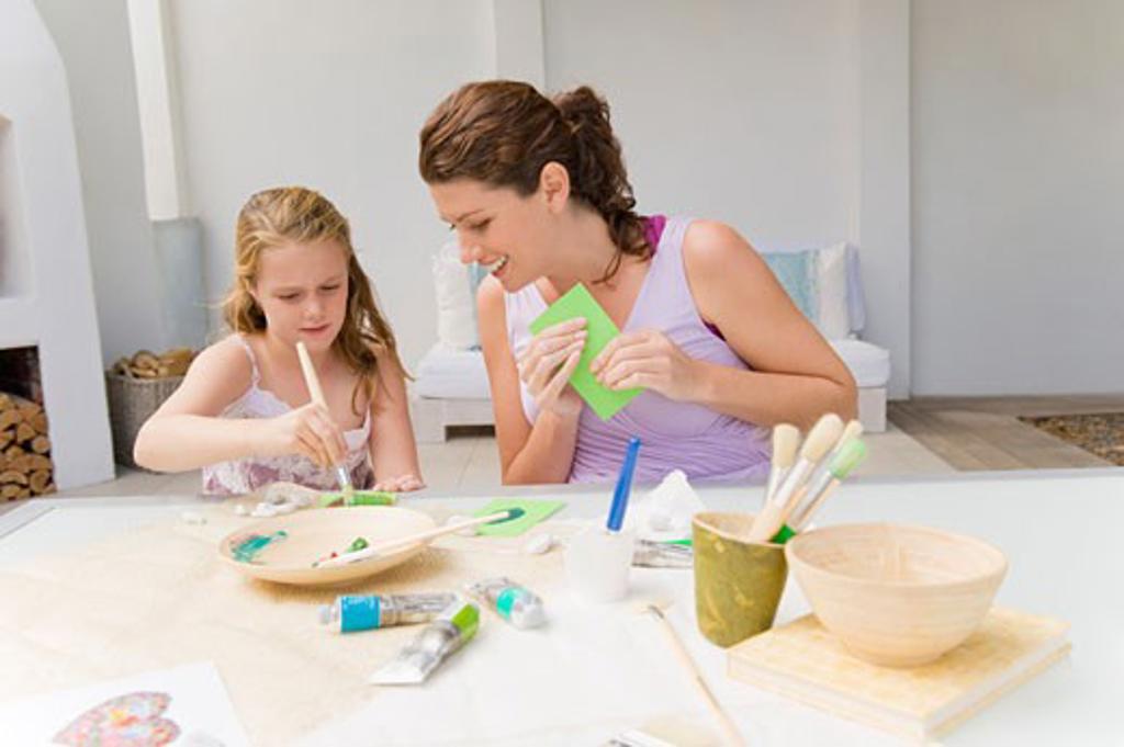 Woman teaching her daughter : Stock Photo