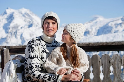 Stock Photo: 1738R-17181 Mother and daughter on balcony at ski resort