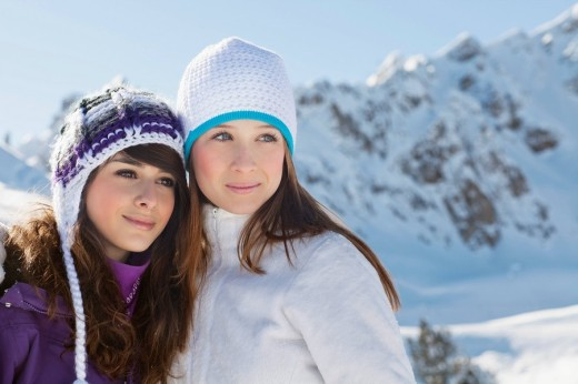 Stock Photo: 1738R-17372 Two teenage girls in winter clothes, embracing