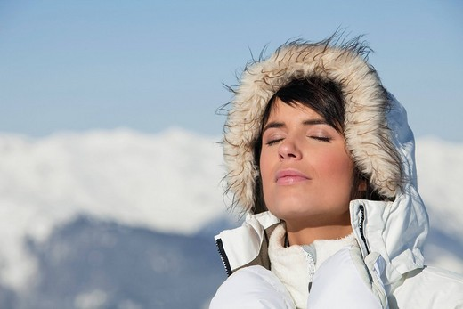 Young woman enjoying winter sun : Stock Photo