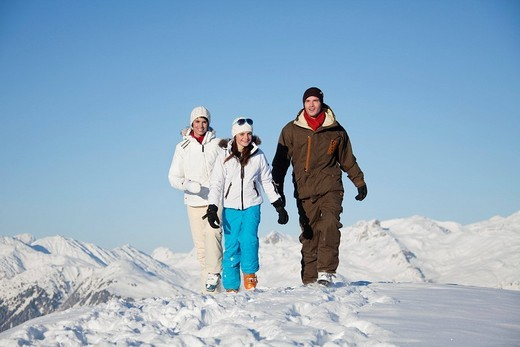 Stock Photo: 1738R-17522 Couple and daughter in ski wear walking in snow