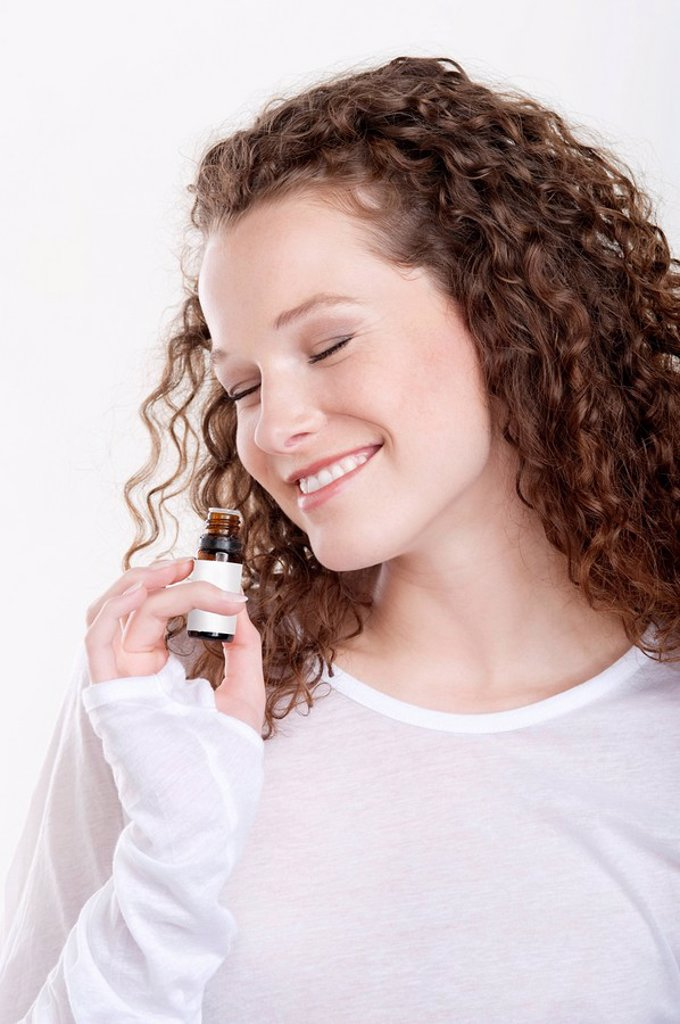 Stock Photo: 1738R-18371 Woman smelling aromatherapy oil