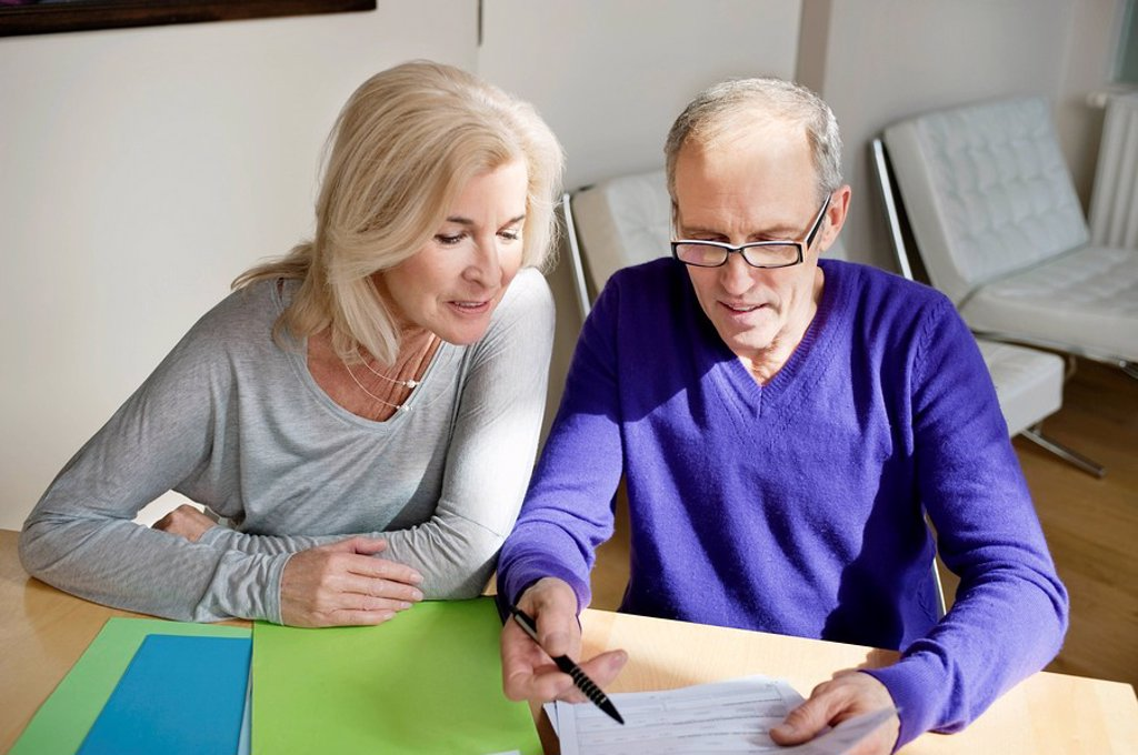 Stock Photo: 1738R-18917 Couple sorting out bills