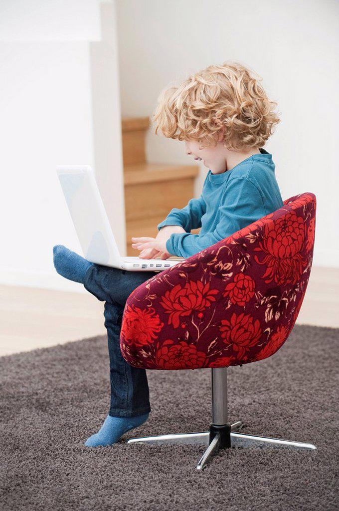 Boy using a laptop : Stock Photo