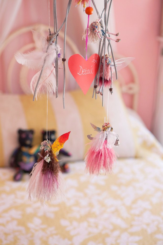 Close_up of wind chime decorated in a bedroom : Stock Photo