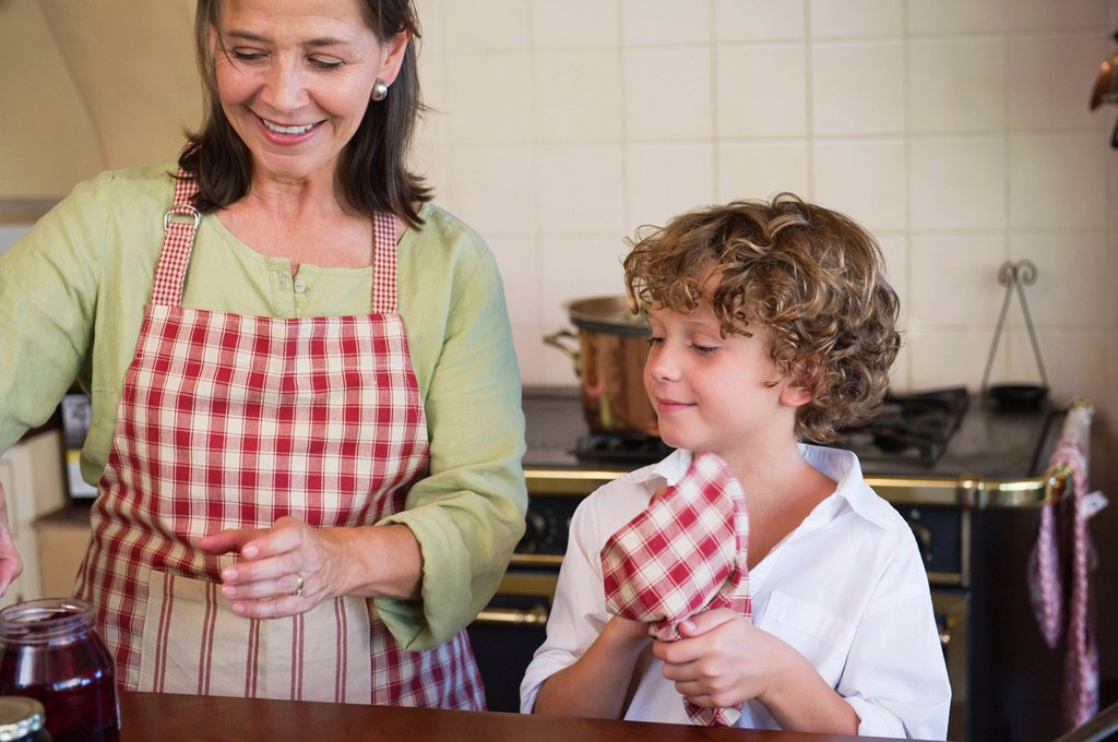 Stock Photo: 1738R-22565 Grandmother and little boy cooking food at kitchen