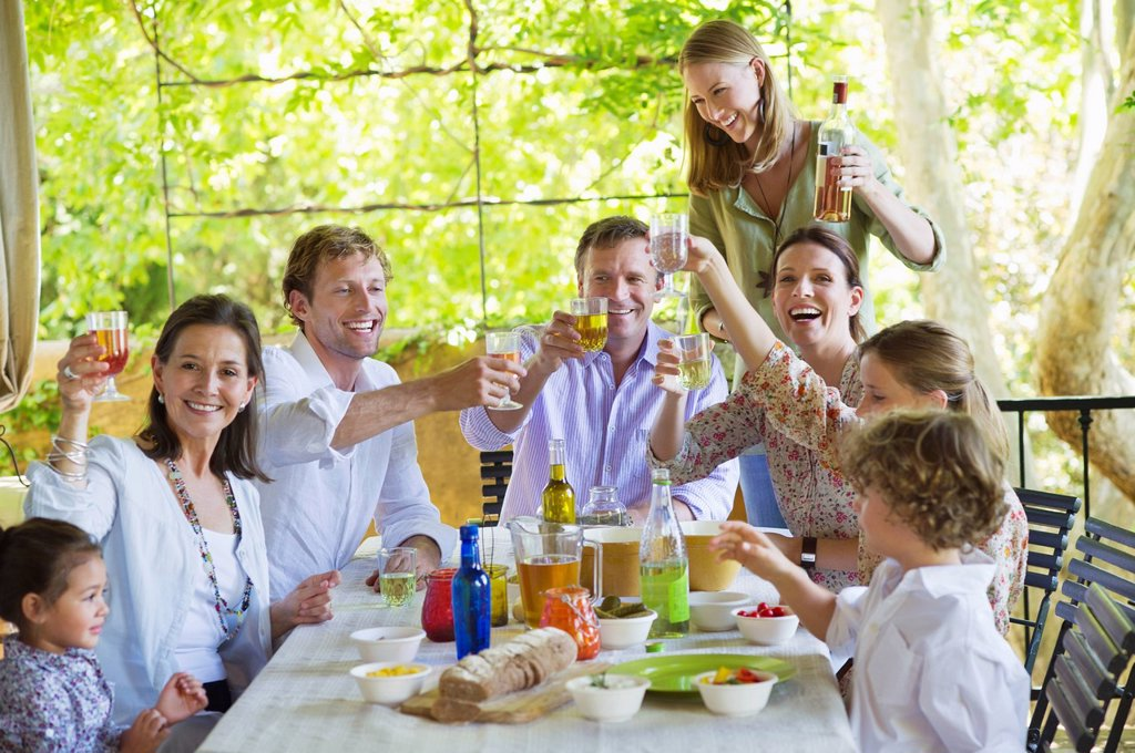 Multi generation family eating food at house : Stock Photo