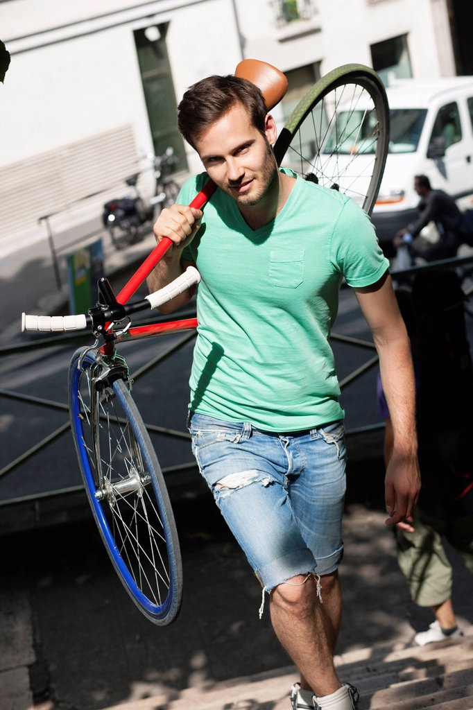 Stock Photo: 1738R-24019 Man carrying a sports bicycle on his shoulders, Paris, Ile_de_France, France